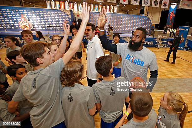 James Harden of the Houston Rockets works with kids during the Jr NBA Day as part of 2016 AllStar Weekend at NBA Centre Court of the Enercare Centre...