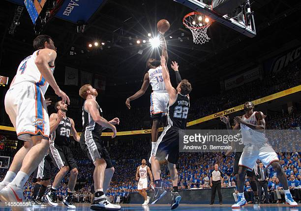 James Harden of the Oklahoma City Thunder goes to the basket against Tiago Splitter of the San Antonio Spurs in Game Three of the Western Conference...