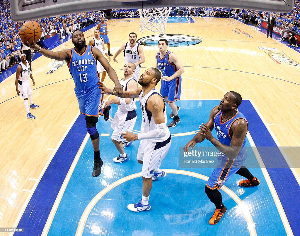 James Harden #13 of the Oklahoma City Thunder goes up for a shot against Tyson Chandler #6 of the Dallas Mavericks in the first half in Game Five of the Western Conference Finals during the 2011 NBA Playoffs at American Airlines Center on May 25, 2011 in Dallas, Texas.