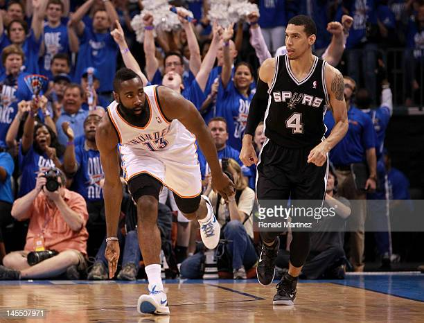 James Harden of the Oklahoma City Thunder reacts after making a three-pointer alongside Danny Green of the San Antonio Spurs in the first half in...