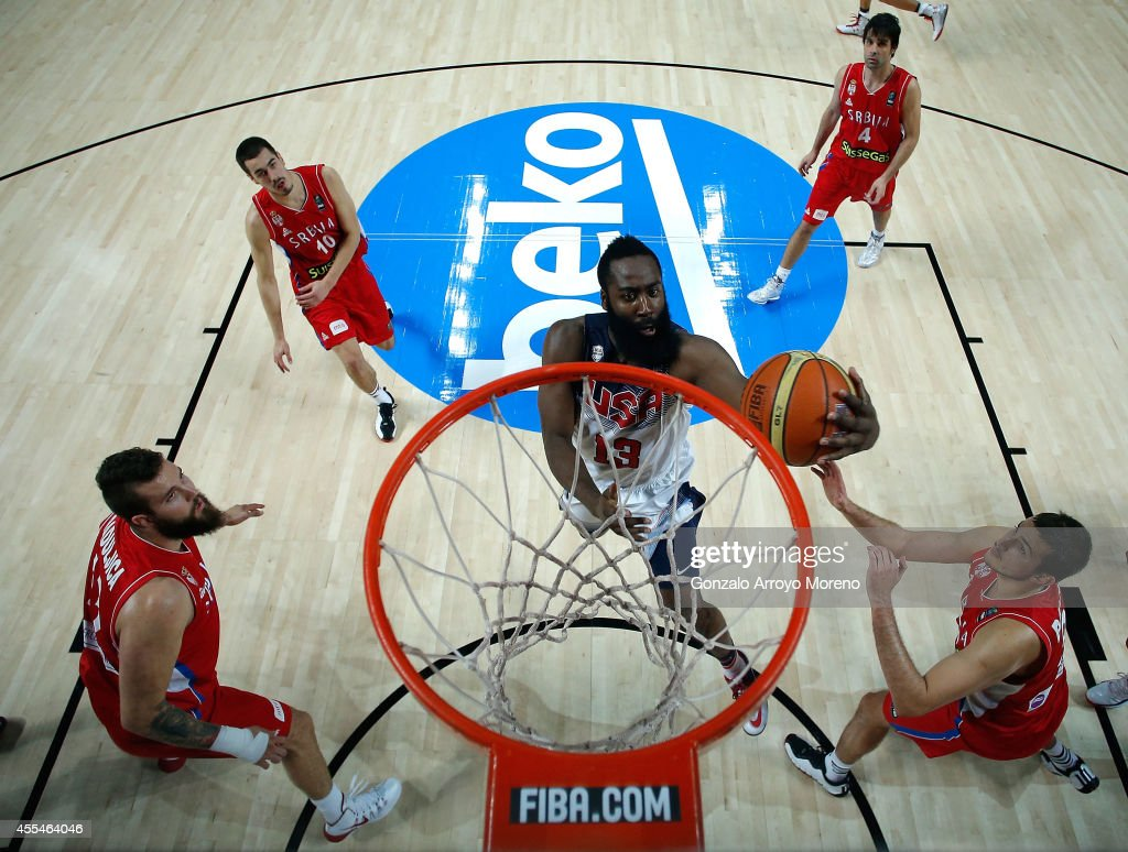 James Harden (2ndR) of the USA shoots against Nemanja Bjelica (R) of Serbia during the 2014 FIBA World Basketball Championship final match between USA and Serbia at Palacio de los Deportes on September 14, 2014 in Madrid, Spain.