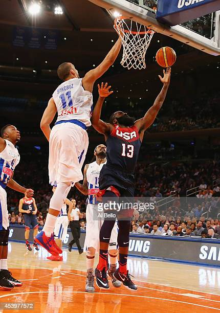 James Harden of the USA shoots against Ricardo Sanchez of Puerto Rico during their game at Madison Square Garden on August 22 2014 in New York City
