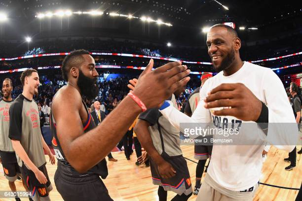 James Harden of the Western Conference AllStar Team shakes hands with LeBron James of the Eastern Conference AllStar Team after the NBA AllStar Game...