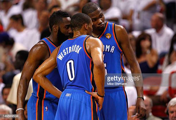 James Harden Russell Westbrook and Kevin Durant of the Oklahoma City Thunder talk on court against the Miami Heat in Game Four of the 2012 NBA Finals...