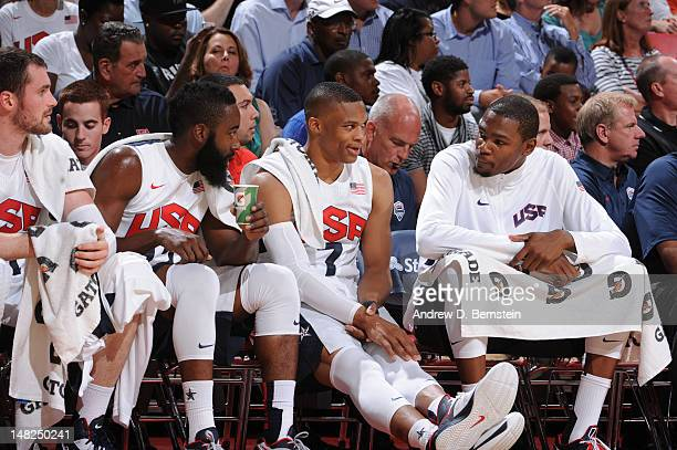 James Harden Russell Westbrook and Kevin Durant of the US Men's Senior National Team talks on the bench against the Dominican Republic during an...