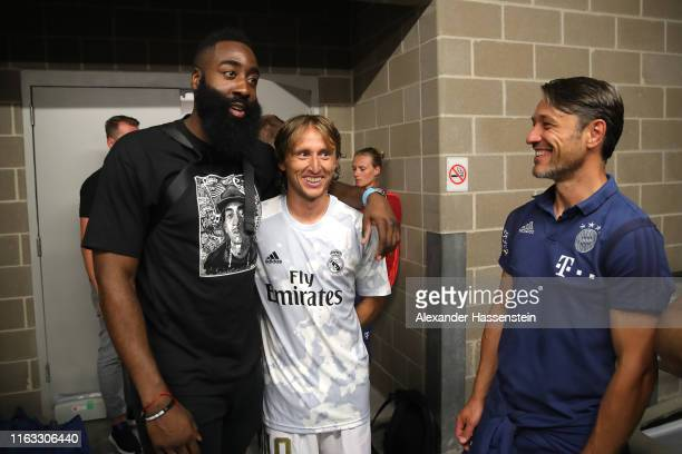 James Harden talks to Luka Modric of Real and Niko Kovac, head coach of Bayern Muenchen after the International Champions Cup match between Bayern...