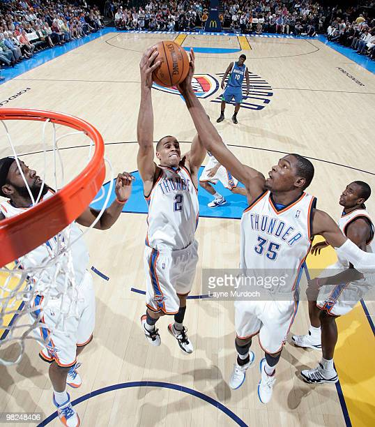 James Harden Thabo Sefolosha and Kevin Durant all of the Oklahoma City Thunder go up for a rebound during the game against the Minnesota Timberwolves...
