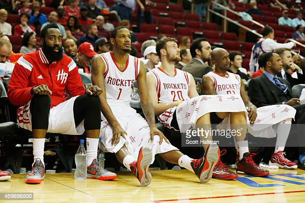 James Harden Trevor Ariza Donatas Motiejunas and Jason Terry of the Houston Rockets sit on the bench late in their game against the Los Angeles...