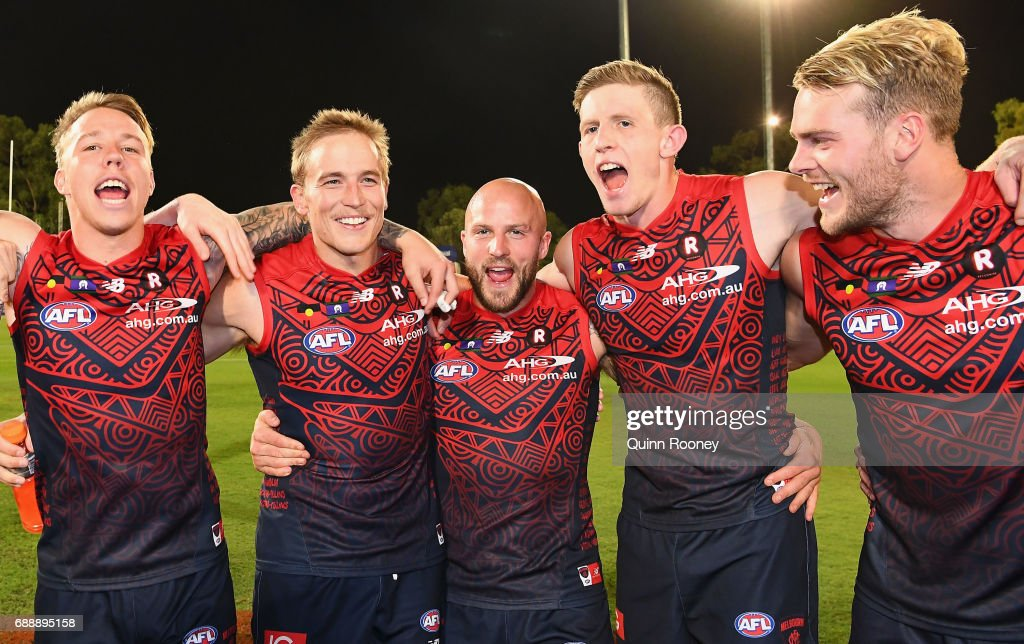 James Harmes, Bernie Vince, Nathan Jones, Sam Frost and Jack Watts of the Demons sing the song after winning the round ten AFL match between the Melbourne Demons and the Gold Coast Suns at Traeger Park on May 27, 2017 in Alice Springs, Australia.