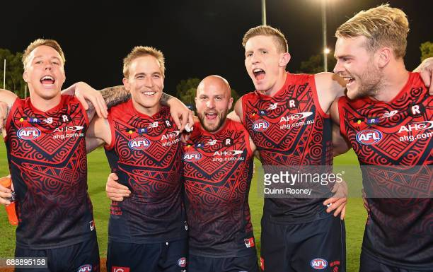 James Harmes Bernie Vince Nathan Jones Sam Frost and Jack Watts of the Demons sing the song after winning the round ten AFL match between the...