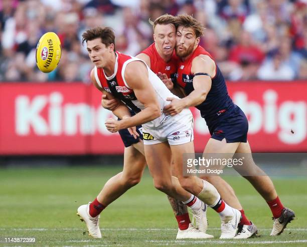 James Harmes of the Demons and Jack Viney collide as they try to tackle Jack Sinclair of the Saints during the round 5 AFL match between Melbourne...