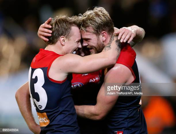 James Harmes of the Demons and Jack Watts of the Demons celebrate on the siren during the 2017 AFL round 12 match between the Melbourne Demons and...
