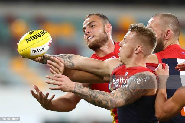 James Harmes of the Demons and Jarrod Witts of the Suns compete for the ball during the round eight AFL match between the Gold Coast Suns and the...