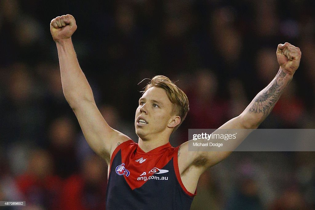 James Harmes of the Demons celebrates a goal during the round 23 AFL match between the Melbourne Demons and the Greater Western Sydney Giants at Etihad Stadium on September 6, 2015 in Melbourne, Australia.