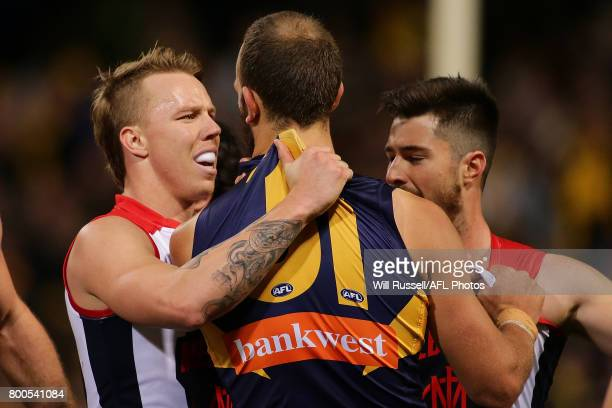 James Harmes of the Demons grabs Will Schofield of the Eagles during the round 14 AFL match between the West Coast Eagles and the Melbourne Demons at...