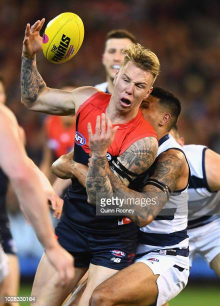James Harmes of the Demons is tackled by Tim Kelly of the Cats during the AFL First Elimination Final match between the Melbourne Demons and the...