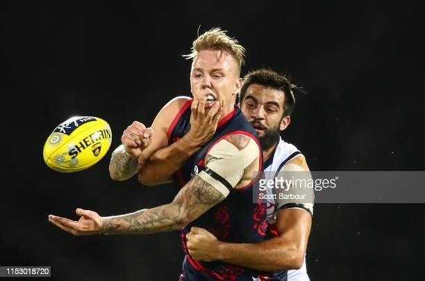 James Harmes of the Demons is tackled by Wayne Milera of the Crows during the round 11 AFL match between the Melbourne Demons and the Adelaide Crows...