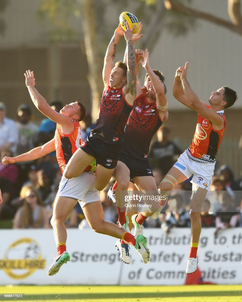 James Harmes of the Demons marks over Steven May of the Suns during the round ten AFL match between the Melbourne Demons and the Gold Coast Suns at Traeger Park on May 27, 2017 in Alice Springs, Australia.