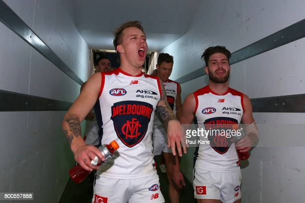 James Harmes of the Demons walks down the race after winning the round 14 AFL match between the West Coast Eagles and the Melbourne Demons at Domain...
