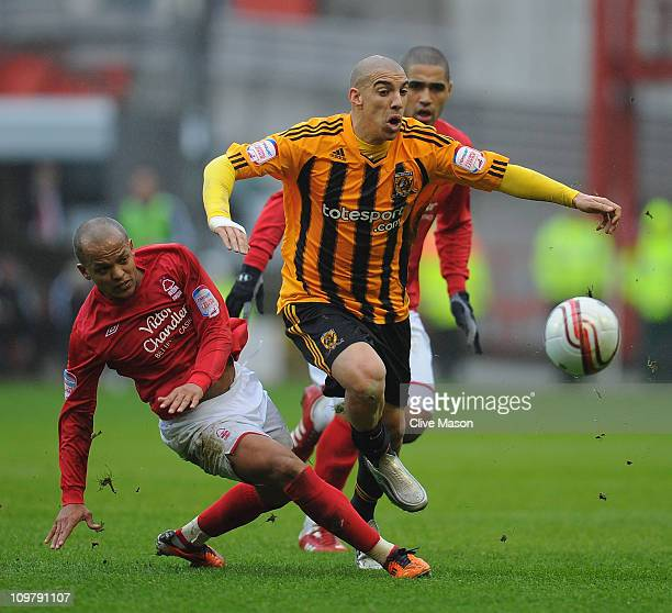 James Harper of Hull City is challenged by Robert Earnshaw of Nottingham Forest during the npower Championship match between Nottingham Forest and...