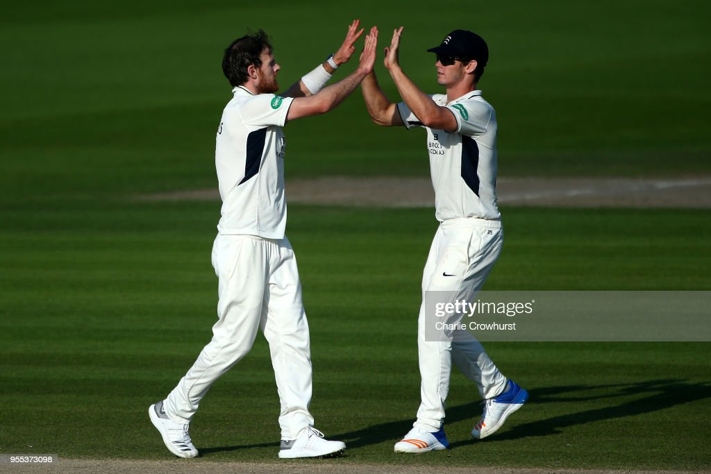 James Harris of Middlesex (L) celebrates after taking the wicket of Phillip Salt of Sussex during day three of the Specsavers County Championship: Division Two match between Sussex and Middlesex at The 1st Central County Ground on May 6, 2018 in Hove, England.