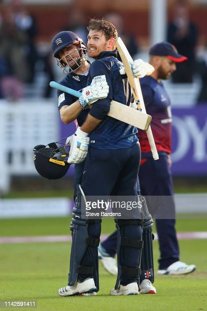 James Harris of Middlesex celebrates reaching his century with John Simpson during the Royal London One Day Cup Quarter Final match between Middlesex...