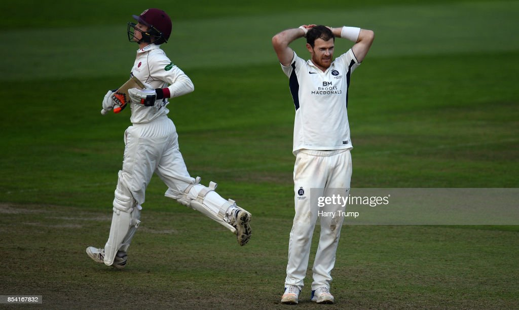 James Harris of Middlesex (R) cuts a dejected figure during Day Two of the Specsavers County Championship Division One match between Somerset and Middlesex at The Cooper Associates County Ground on September 26, 2017 in Taunton, England.