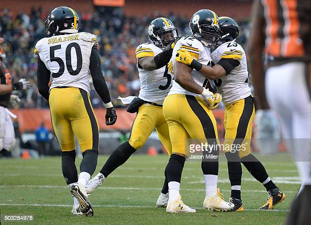 James Harrison celebrates his pass interception with Arthur Moats and Mike Mitchell of the Pittsburgh Steelers during the third quarter against the...
