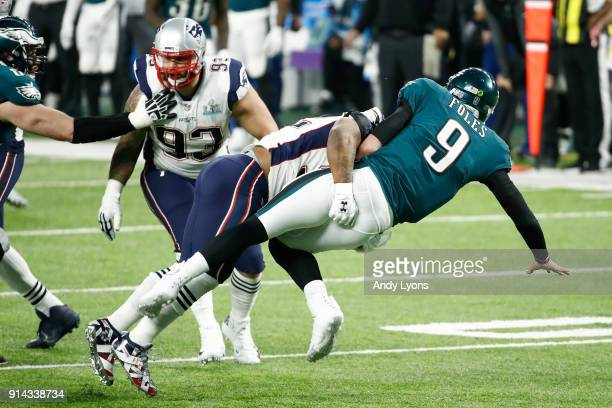 James Harrison of the New England Patriots hits Nick Foles of the Philadelphia Eagles during the fourth quarter in Super Bowl LII at US Bank Stadium...