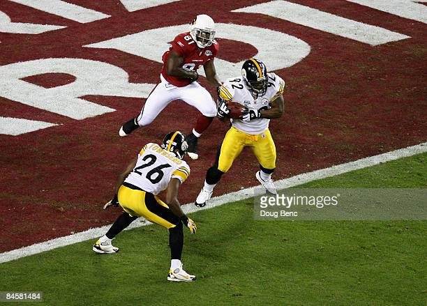 James Harrison of the Pittsburgh Steelers makes an interception in the Cardinals endzone in the second quarter against the Arizona Cardinals during...