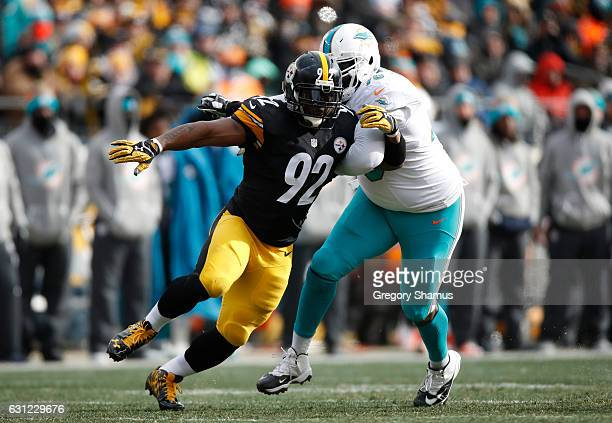 James Harrison of the Pittsburgh Steelers pressures quarterback Matt Moore of the Miami Dolphins during the second quarter in the AFC Wild Card game...