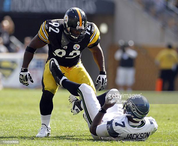 James Harrison of the Pittsburgh Steelers reacts to sacking Tarvaris Jackson of the Seattle Seahawks during the game on September 18 2011 at Heinz...