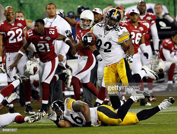 James Harrison of the Pittsburgh Steelers returns an interception 100yards for a touchdown in the second quarter against the Arizona Cardinals during...