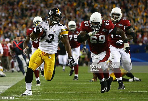 James Harrison of the Pittsburgh Steelers runs back an interception for a touchdown in the second quarter against Mike Gandy of the Arizona Cardinals...