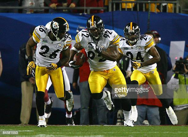 James Harrison of the Pittsburgh Steelers runs back an interception for 100 yards to score a touchdown in the second quarter against the Arizona...