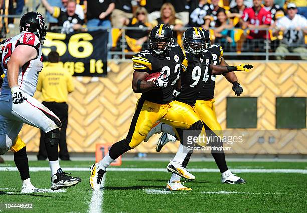 James Harrison of the Pittsburgh Steelers runs with a fumble recovery against the Atlanta Falcons at Heinz Field on September 12 2010 in Pittsburgh...