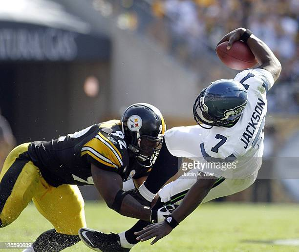 James Harrison of the Pittsburgh Steelers sacks Tarvaris Jackson of the Seattle Seahawks during the game on September 18 2011 at Heinz Field in...
