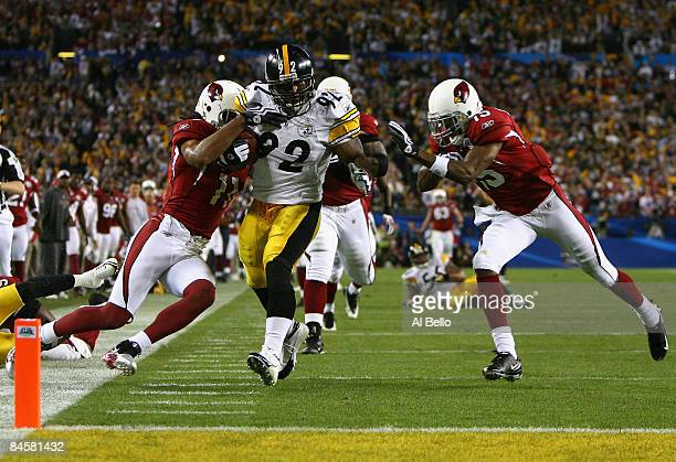 James Harrison of the Pittsburgh Steelers scores a touchdown after running back an interception for 100 yards in the second quarter against Larry...