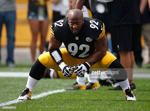 James Harrison of the Pittsburgh Steelers warms up prior to the game against the Tampa Bay Buccaneers at Heinz Field on September 28 2014 in...