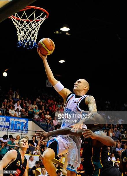 James Harvey of the Blaze makes a layup over Corey Williams of the Crocodiles during the round 15 NBL match between the Townsville Crocodiles and the...
