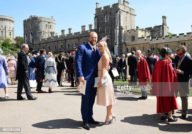 James Haskell and Chloe Madeley leave St George's Chapel at Windsor Castle after the wedding of Meghan Markle and Prince Harr on May 19 2018 in...