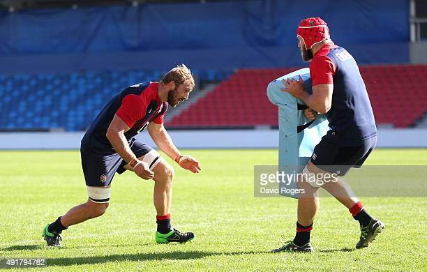 James Haskell and Chris Robshaw take part in tackle practice during the England training session held at the AJ Bell Stadium on October 8 2015 in...