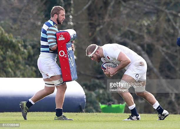 James Haskell charges into the tackle bag held by Chris Robshaw during the England training session held at Pennyhill Park on February 25 2016 in...