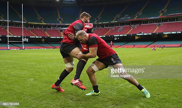 James Haskell is tackled by Dave Attwood during the England captain's run at the Millennium Stadium on February 5 2015 in Cardiff Wales