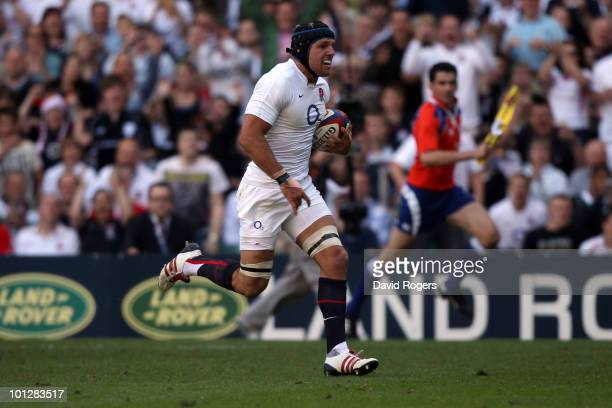 James Haskell of England breaks through the Barbarians defence and scores a try during the MasterCard Trophy match between England and Barbarians at...