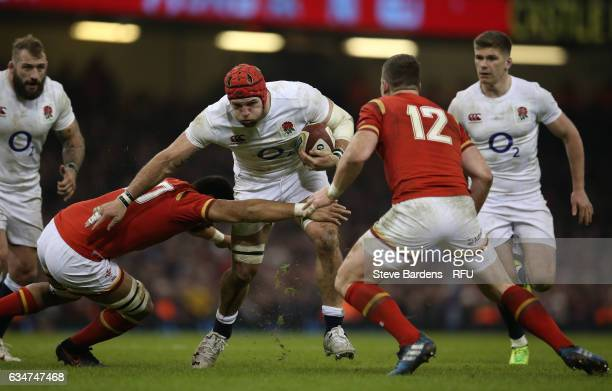 James Haskell of England is tackled by Taulupe Faletau and Scott Williams of Wales during the RBS Six Nations match between Wales and England at the...