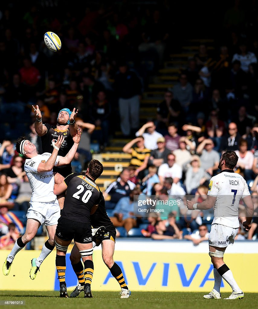 James Haskell of London Wasps and Andy Saull of Newcastle Falcons jump for the ball during the Aviva Premiership match between London Wasps and Newcastle Falcons at Adams Park on May 03, 2014 in High Wycombe, England.