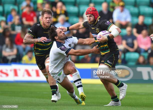 James Haskell of Northampton Saints holds off a challenge by Rémi Lamerat of Clermont Auvergne during the Challenge Cup match between Northampton...