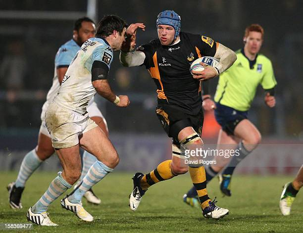 James Haskell of Wasps charges upfield and Thibault Lacroix during the Amlin Challenge Cup match between London Wasps and Bayonne at Adams Park on...