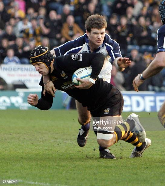 James Haskell of Wasps dives over to score the second try during the Heineken Cup quarter final match between London Wasps and Leinster at Adams Park...